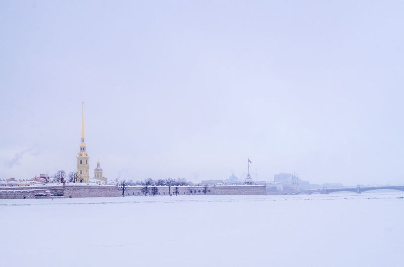View of city against sky during winter