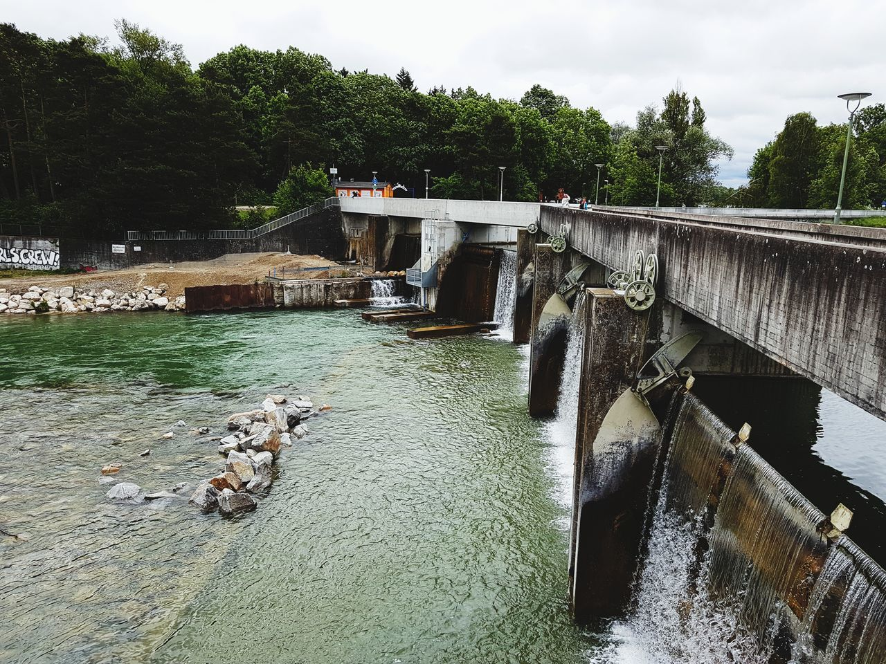 water, bridge - man made structure, river, day, tree, architecture, dam, hydroelectric power, nature, outdoors, built structure, animal themes, mammal, domestic animals, no people, motion, waterfront, sky, pets