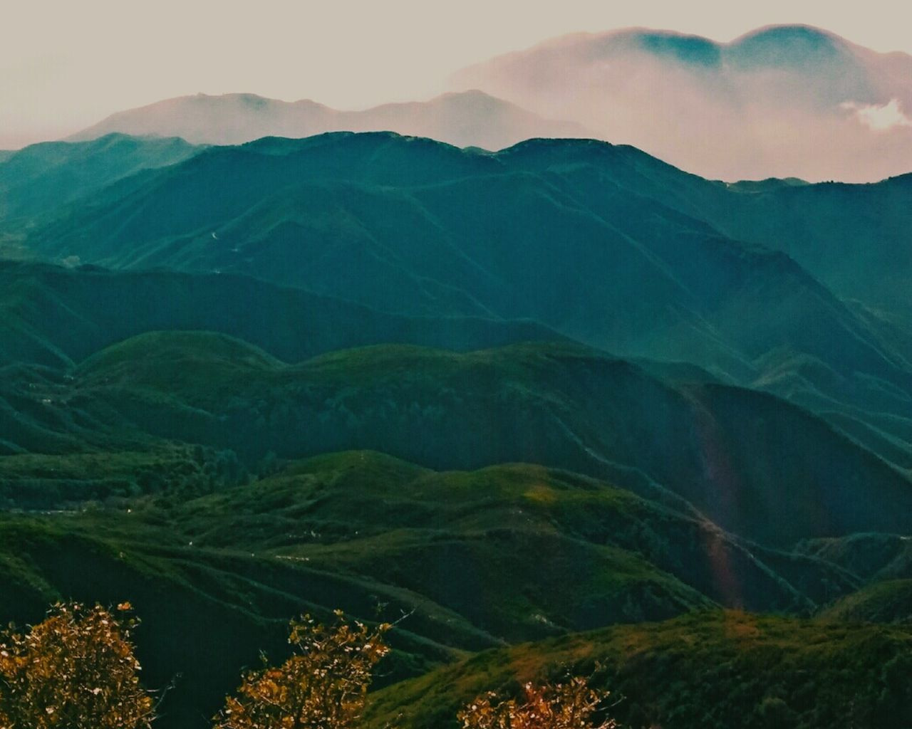 mountain, mountain range, scenics, tranquil scene, tranquility, nature, beauty in nature, outdoors, landscape, green color, physical geography, day, sky, no people