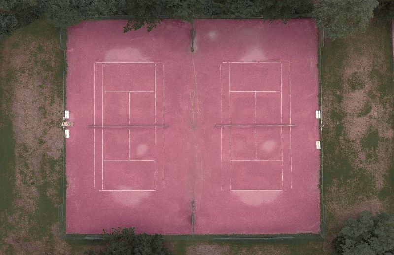 """- THE """"LADIES ONLY"""" TENNIS CLUB - Check This Out DJIxEyeEm Drone  Architecture Building Building Exterior Built Structure Closed Day Door Drone Photography Dronephotography Entrance House Love Nature No People Outdoors Pink Color Plant Positive Emotion Residential District Wall Wall - Building Feature Window Humanity Meets Technology"""