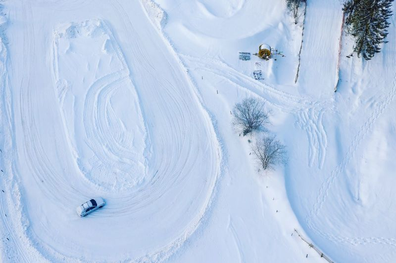 High angle view of car on snow covered land