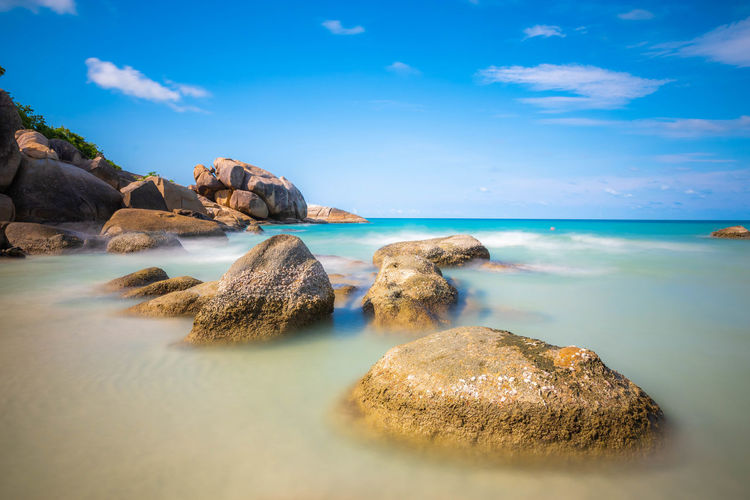 Long exposure shot of sea and the rocks on the beach in koh samui.