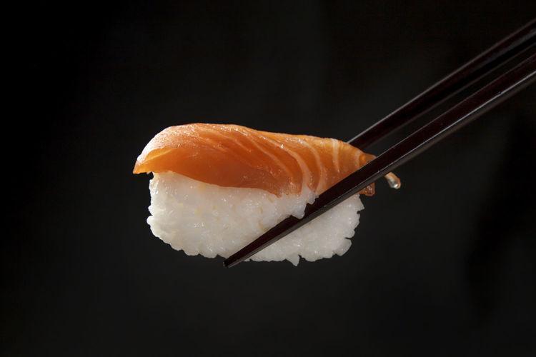 Close-up of orange fish on black background