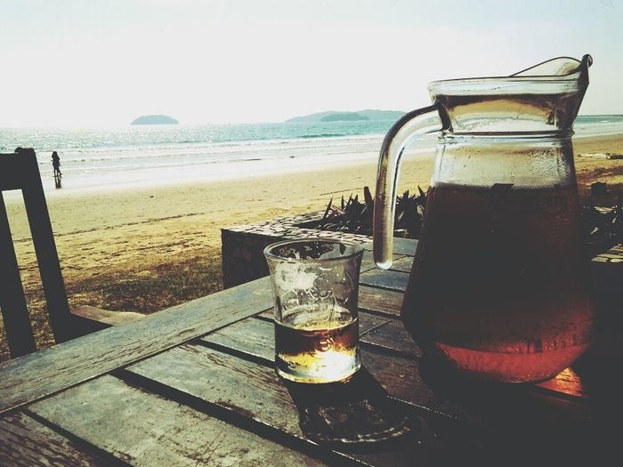 Basking the sun with a jug of cold beer Relaxing Enjoying The Sun Sea