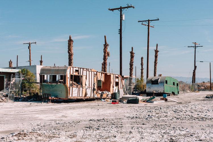 Abandoned vehicle trailer on land against sky