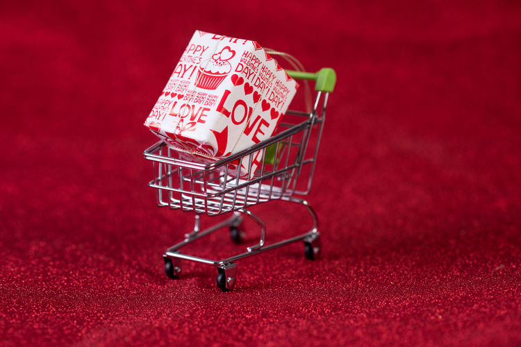 Shopping Trolley Cart Supermarket Isolated Grocery Store Retail  White Background Market Food Buy Shop Customer  Purchase Consumer Young Sale Man Empty Woman Commerce Basket Full Consumerism Metal Product person Products Closeup Business Female Adult Shopper Casual Mall Pushcart People Happy Lifestyle Caucasian Object One Concept Wheel Hypermarket Variety Purchasing