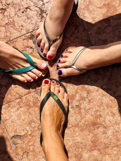 Girlfriends make the world go round! Friendship Human Body Part Real People Body Part Human Leg Sunlight Land International Women's Day 2019 Togetherness Nail Polish Women Leisure Activity High Angle View Beach