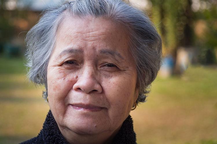 Close-up portrait of smiling elderly woman