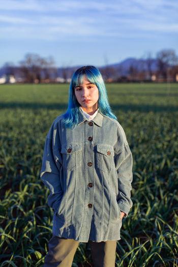 Portrait of woman standing on field