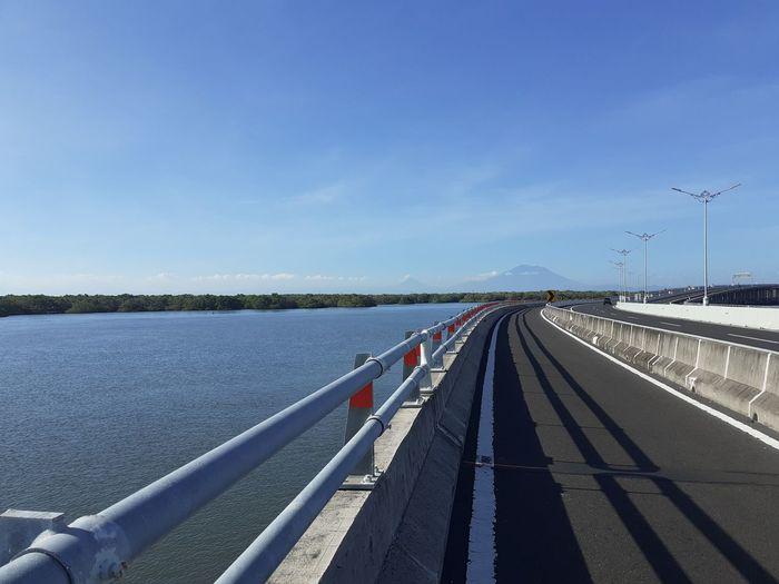 Bridge over river against blue sky