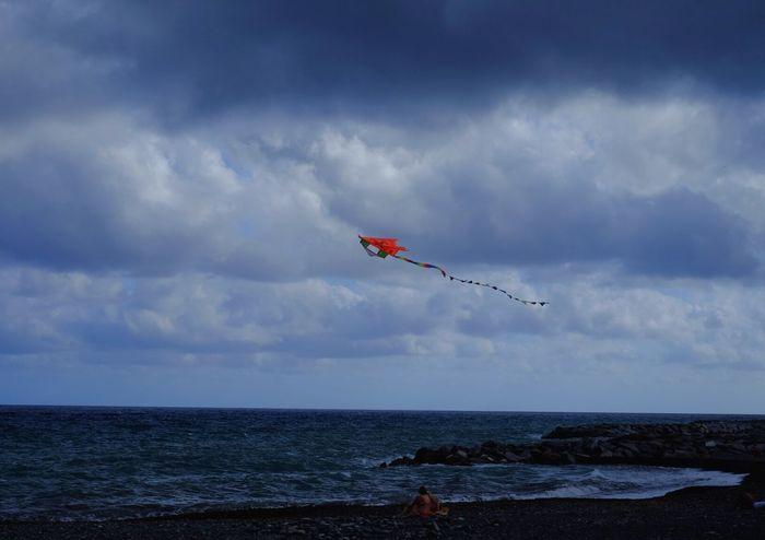 Flying Sea Mid-air Sky Beach Red Nature Water Outdoors Day Horizon Over Water Cloud - Sky Kite - Toy Airshow No People Vapor Trail Tranquility EyeEm Selects Fujixt1 Fujifilm_xseries Xt1 Fuji X-T1 Fuji Xt1 Fuji Nature