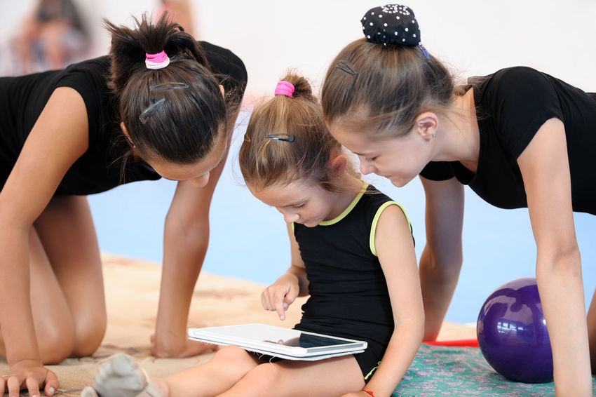Athlete Caucasian Child Computer Exercise Exercises  Female Gadget Girl Group Gymnast  Gymnastics Leisure Sportive Sportsman Stretch Student TAB Teenager Touch Pad