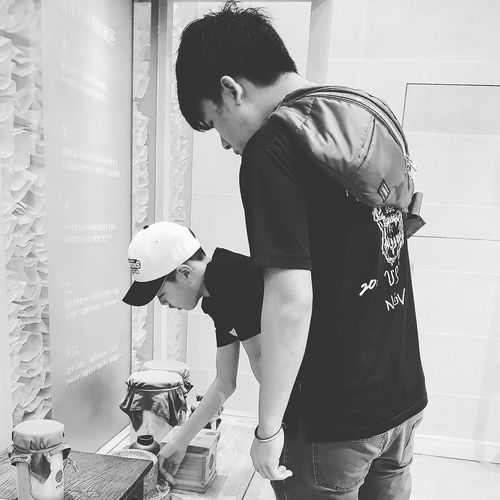 Looking at traditional korean Grinders etc Osulloc Tripwithson2017 Tripwithsonmay2017 Bnwphotography Bnwseoul Bnwstreetphotography Streetphotography Seoul Streetphotography Insadong Seoul South Korea My Son with Ju-An