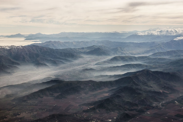 Aerial View Of Mountains In Foggy Weather
