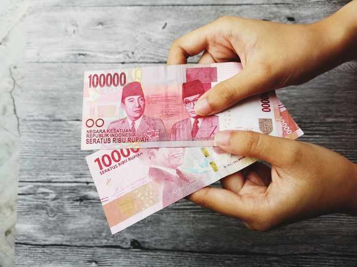 Hand show a INDONESIA rupiah money with wooden background Background Color Black Shadow Art Object Attraction INDONESIA Money Money Money Rupiah Hand Show Color EyeEm Selects Human Hand Gambling Counting Paper Currency Currency Finance Wealth Close-up Chance Money Finance And Economy