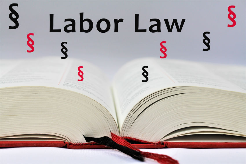 An concept Image of a Labor law Desk Employee Lawyer Rights Statue Text Work Book Close-up Concept Cort Employees Employment Indoors  Judge Justice Labor Law Legal No People Protection