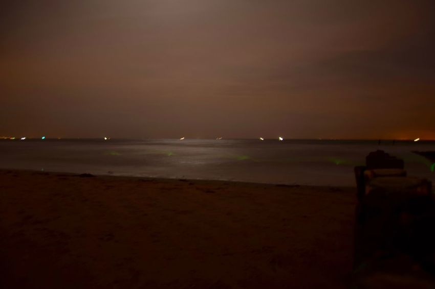 Beach Beauty In Nature Illuminated Nature Night No People Outdoors Scenery Scenics Sea Sky Sunset Tranquility Water