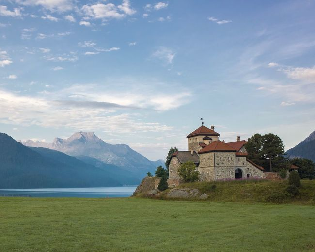 Schloss Crap da Sass, silvaplana Surlej Lake Green Color Blue Building Exterior Castle Morning Light Tourism Engadin Crap Da Sass Mountain Sky Architecture Built Structure Plant Cloud - Sky Travel Destinations Nature No People Mountain Range Beauty In Nature Travel