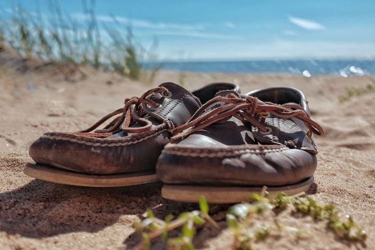 Worn out pair of shoes. Sand Beach No People Pair Day Nature Close-up Sea Water Outdoors Shoes Timberland Topsiders Worn Out Leather Shoes