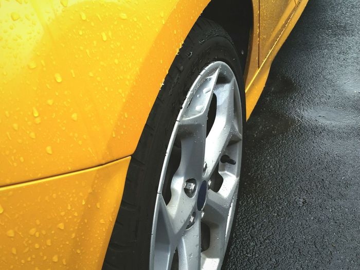 Close-up of wet car