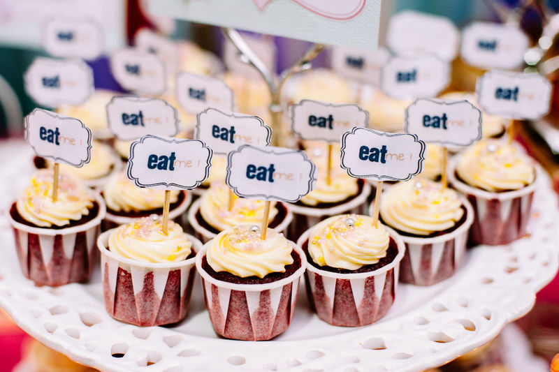 Eat me text on cupcakes