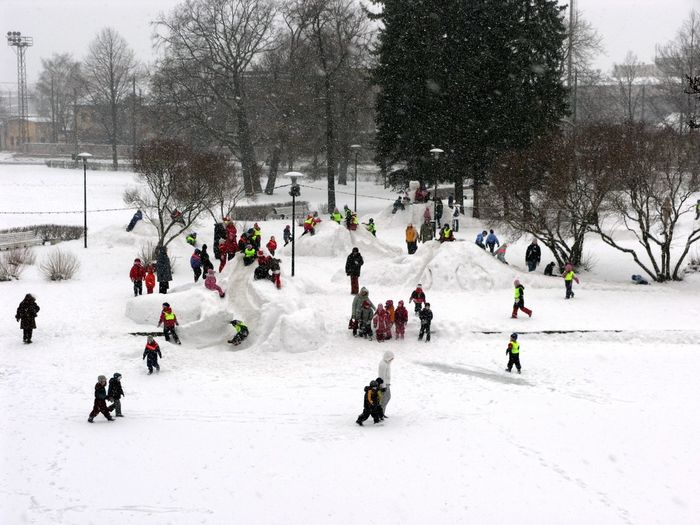 Group of people playing in snow