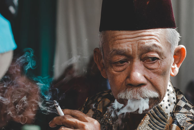old man smoking Old Old Man Smoking Smoke Old Man Smoking Lifestyles Potrait Smoke - Physical Structure Culture Cigarette  Human Face Human Representation Representation Indonesia_photography Human Interest Vintage Close-up