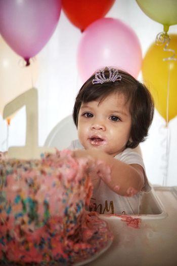 Cute girl having cake in party