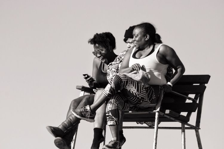Sitting Real People Young Women Leisure Activity Young Adult Friendship Women Outdoors Black And White Coney Island / Brooklyn NY Black And White Photography Lifeguard Stand Lifeguard Station Brooklyn Ny Smiling Happiness Togetherness Sitting Bench Black Woman Girls Girl Power