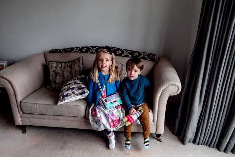 Family Furniture Sofa Child Childhood Full Length Togetherness Indoors  Sitting Women Females Girls Domestic Room Sibling Family Two People Bonding Brother Offspring Living Room Sister Innocence