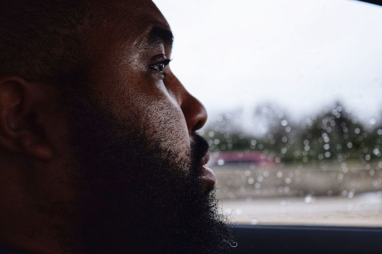 Close-up of bearded man sitting in car