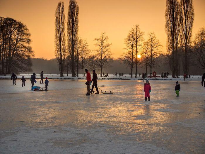 English Garden in Munchen Winter Ice Rink Lifestyles Outdoors Snow Skating Winter Sport Frozen Sky Ice Skate Ice-skating Nature Winter Munich München Allemagne Deutschland