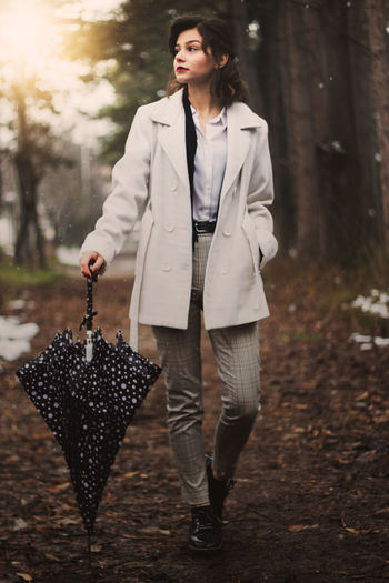 Fashion Fashion Photography Beauty In Nature Autumn Fall Pretty Girl Pretty Woman Wood Woods Forest Portrait Photography Female Portraits Tree Young Women Portrait Full Length Women Business Females Working Beautiful Woman Trench Coat Film Noir Style