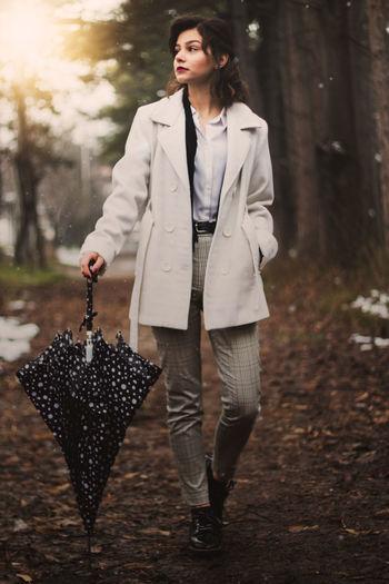 Full Length Of Woman Walking On Field