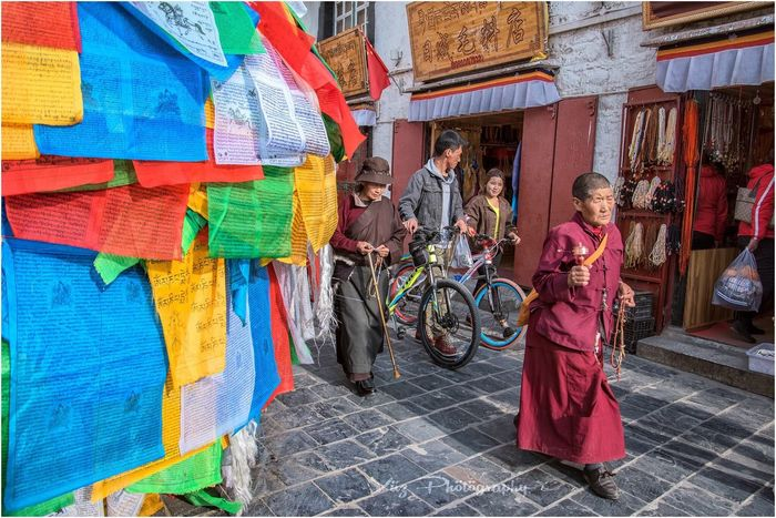 Nikontop Nikonworld_ Multi Colored People Tibet Travel Traditional Clothing Tibet Passion Vibrance Travelphotography Travel Destinations Nikond750 Nikonphotography Place Of Worship Religion Cultures NikonAsia Lonelyplanet Buddhist Pilgrimage Culture Passionforphotography