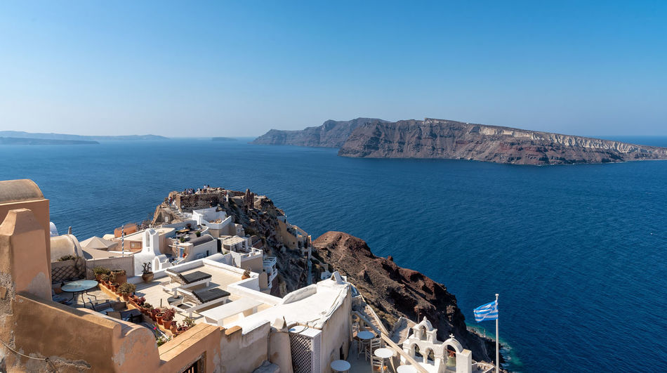 View of Oia - Santorini Cyclades Island - Aegean sea - Greece Greece Santorini Oia Cityscape Cyclades Island Mediterranean  Luxury Water Sea Architecture Scenics - Nature Nature Built Structure Blue Mountain Building Exterior Copy Space Clear Sky Beauty In Nature Travel Destinations Sunlight Solid Building Horizon Over Water