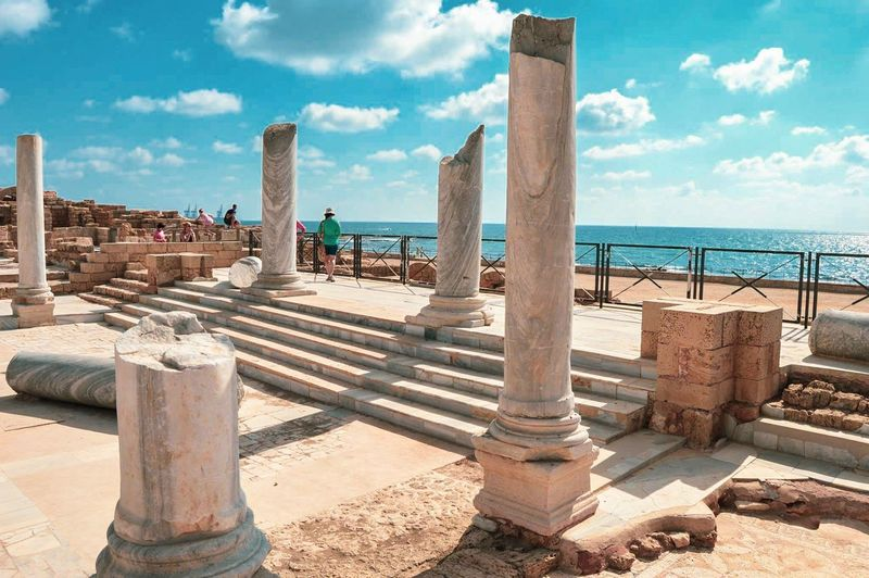 Caesarea's Antiquities Park Caesarea Israel Roman Architecture Roman Columns And Pillars Ruins Architecture Ruins Water Sunlight Sky Day Sand Outdoors Architectural Column Built Structure Land