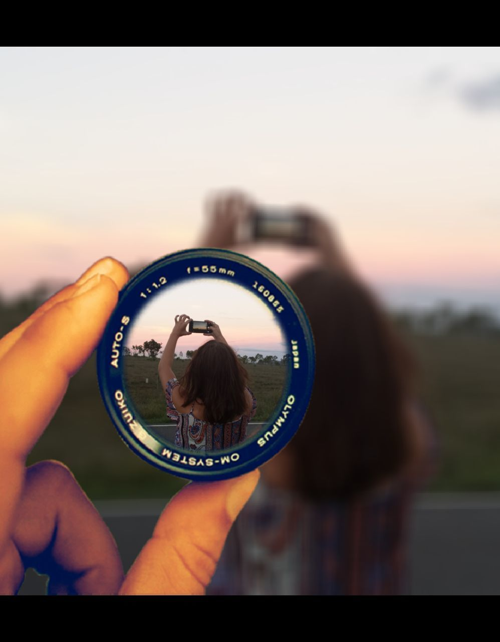 real people, photographing, focus on foreground, holding, human hand, photography themes, sunset, outdoors, two people, close-up, sky, day, camera - photographic equipment, human body part, nature, young adult, people
