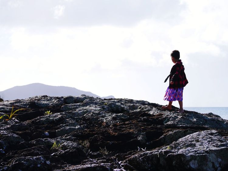 The Great Outdoors - 2017 EyeEm Awards my daughter exploring on some rocks at the beach in new Zealand on a road trip. Cloud - Sky Full Length One Person Mountain Outdoors Landscape Standing Nature Adventure Tranquility Day Cold Temperature Child Climbing Exploring Beauty Childhood Sky Children Only Lost In The Landscape