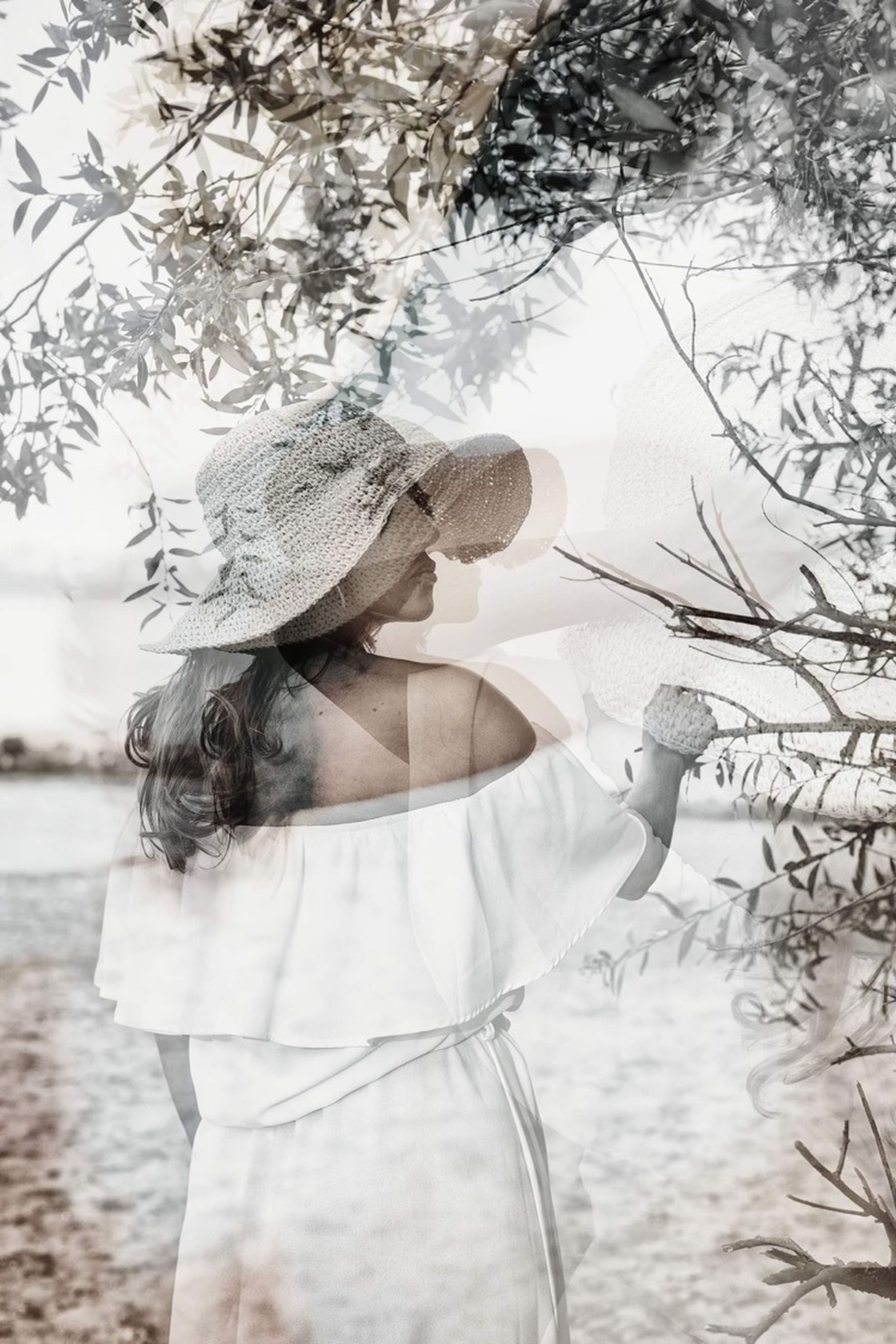 one person, clothing, women, tree, dress, spring, adult, nature, plant, winter, hat, white, young adult, fashion, day, water, three quarter length, bride, wedding dress, fashion accessory, outdoors, standing, female, land, hairstyle, long hair, lifestyles, leisure activity, sketch, branch, rear view, person, tranquility, looking, portrait