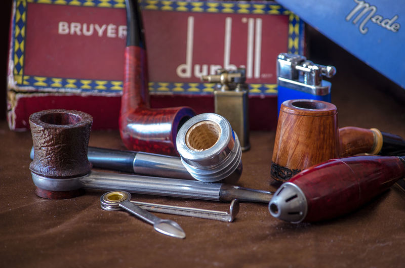 Very unique pipes create an interesting still life with collector boxes and retro pipes. a cigar pipe, art deco cob pipe and an aluminum pipe are part of the collection Objects Retro Tobacco Tobacco Pipe Briar Cigar Pipe Closeup Collection Collector Box Craftsmanship  Ebonite Editorial  Enjoyment Habit Hand Made Handiwork Lifestyles Nicotine Old Pipe Smoking Pipe Still Life Unique Unusual Pipes Vintage Vulconite