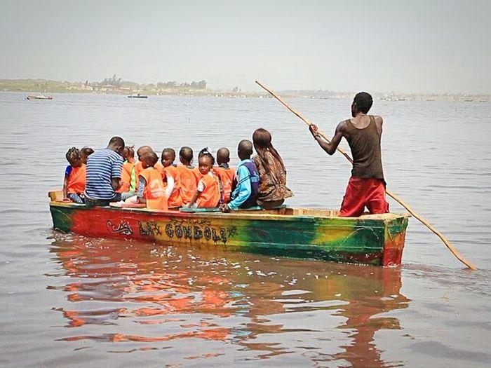 Nautical Vessel Water Transportation People Lake Men Sitting Adult Teamwork Togetherness Sport Oar Outdoors Day Sky