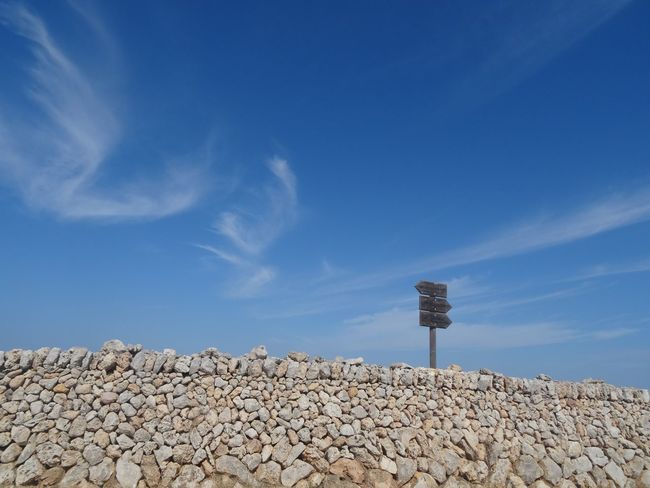 Beauty In Nature Blue Clear Sky Cloud Cloud - Sky Day Low Angle View Nature No People On The Move On The Road On The Way Outdoors Road Sign Scenics Sky Stone Wall Sunny Tranquil Scene Tranquility Color Palette Color Palette