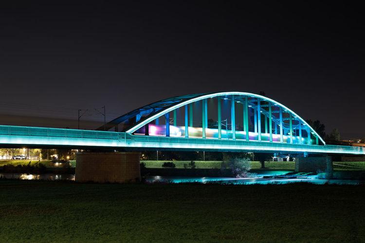 Sea Illuminated City Bridge - Man Made Structure Arts Culture And Entertainment Sky Architecture Waterfront Calm Arch Bridge River Canal