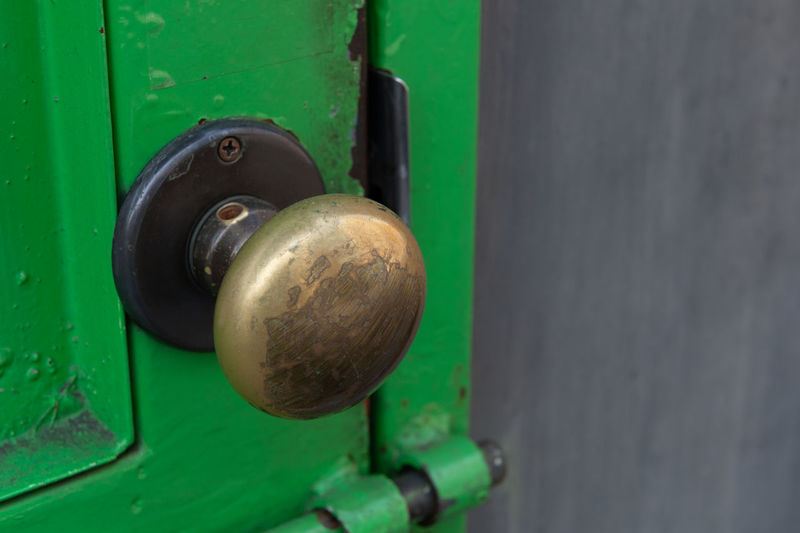 Metal Door Close-up Entrance Doorknob Lock Knob Green Color Protection No People Security Safety Day Old Closed Selective Focus Handle Outdoors Machinery Latch