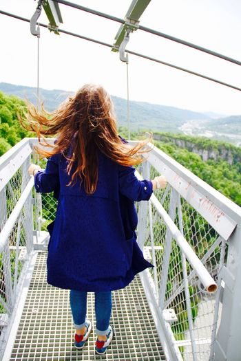 Back View Back View Of Girl Bridge Casual Clothing Extreme Full Length Leisure Activity Lifestyles Long Hair Nature Outdoors Russia Sky Park Sochi Standing Traveling Wind Wind In My Hair Fashion Feel The Journey Hair