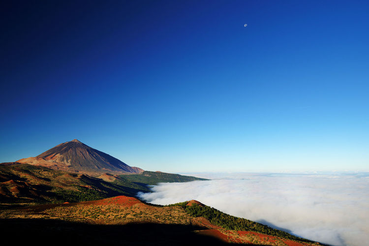 Scenic view of el teide volcano against blue sky