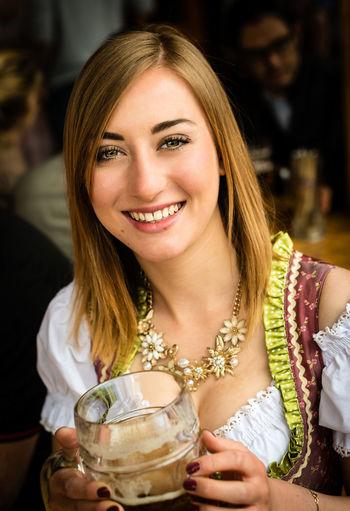 Portrait of beautiful woman holding drink