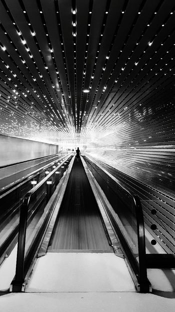 Last time in black and white. Sorry for the influx of posts, guys. I needed to purge my phone of photos. Washington, D. C. National Gallery Of Art Tunnel Architecture Close-up Patterns Lines Lights Vanishing Point Blackandwhite Monochrome Blackandwhite Photography AI Now Mobility In Mega Cities