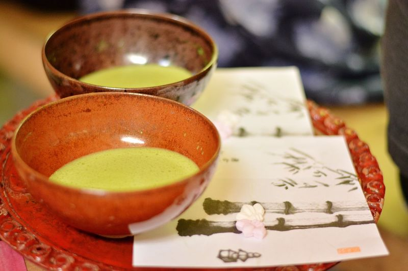 Close-up of japanese green tea in cup on plate
